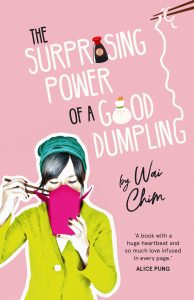 book cover of wai chim's the power of a good dumpling, has a picture of a girl wearing a beanie eating with chopsticks from a noodle box